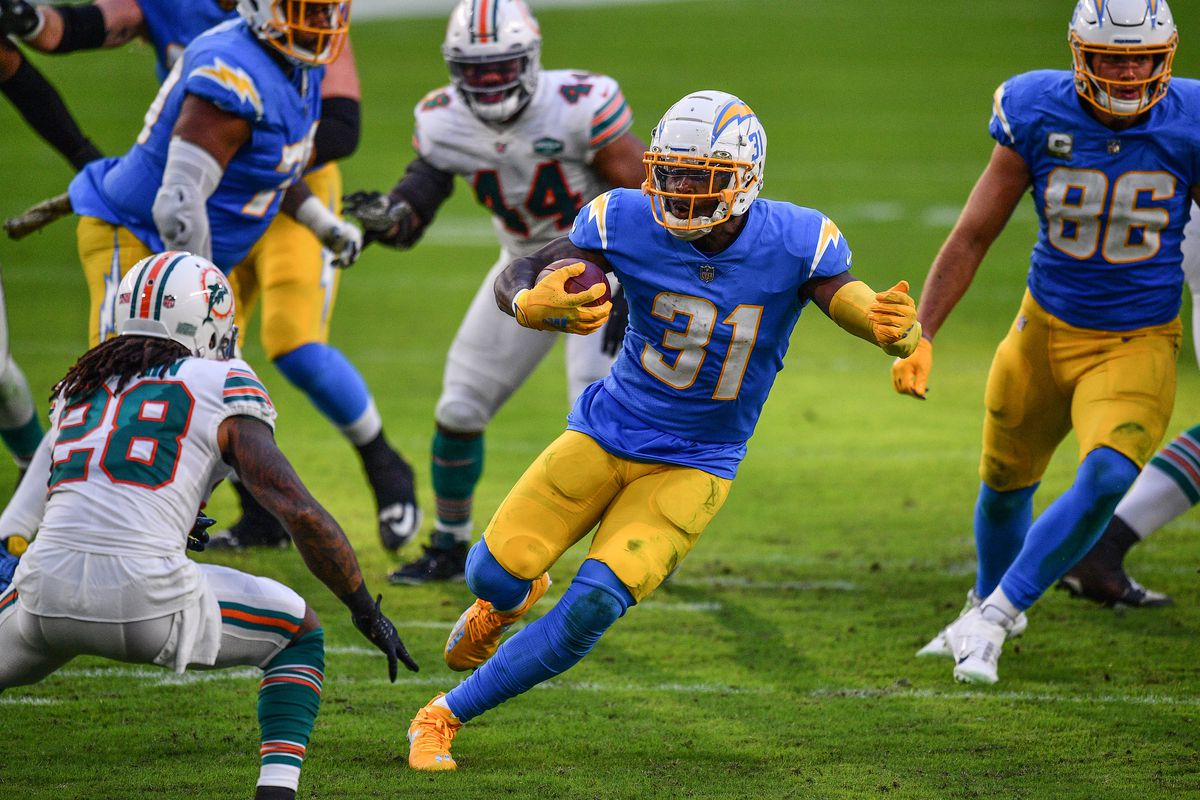 Kalen Ballage #31 of the Los Angeles Chargers runs with the ball against the Miami Dolphins at Hard Rock Stadium on November 15, 2020 in Miami Gardens, Florida.