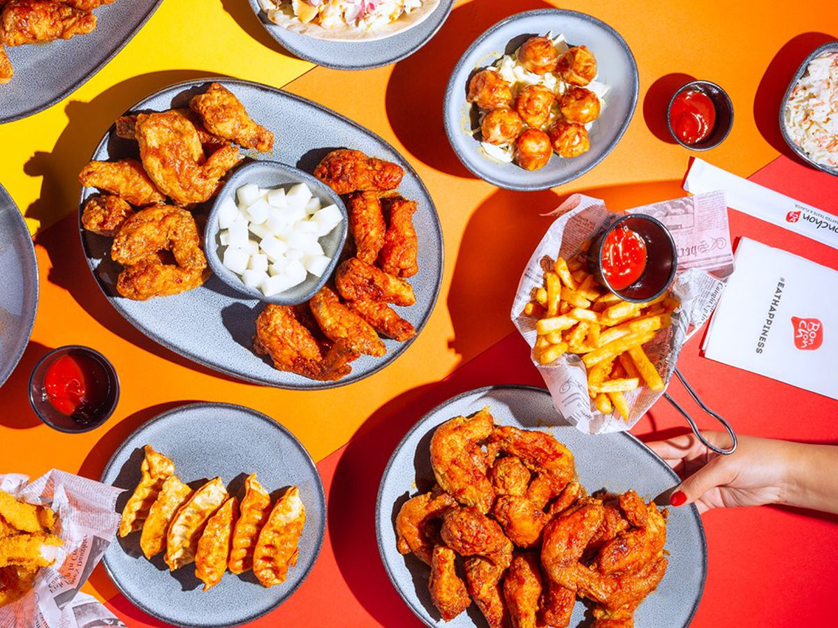 A top-down image of chicken wings and fixings.