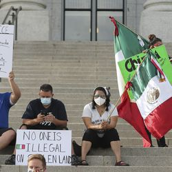 Demonstrators protesting Immigration and Customs Enforcement sit on the steps of the Capitol in Salt Lake City on Saturday, June 27, 2020. They want to hold ICE agents accountable for the treatment of immigrants in detention.