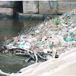 Plastic and other trash litters the shore near the Port of Cleveland at the mouth of the Cuyahoga River on Lake Erie.