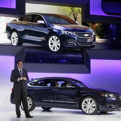 Mark Reuss, president of General Motors North America, presents the 2013 Chevrolet Impala at the New York International Auto Show, in New York's Javits Center,  Wednesday, April 4, 2012. General Motors Co.'s Chevrolet brand is trying to resuscitate sales of big sedans with a sleek, new version of the Impala.