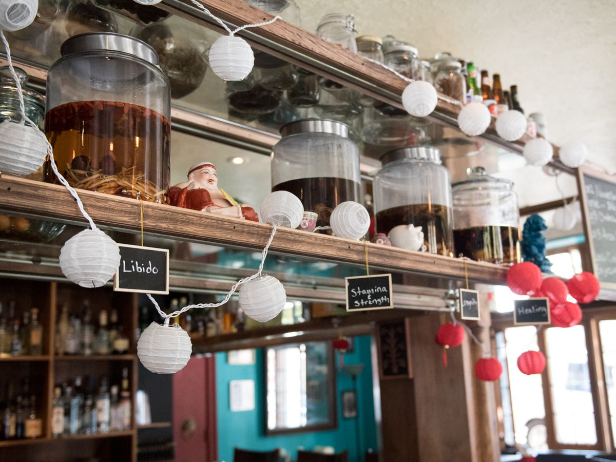 A view of white paper lanterns strewn over the bar at Kedai Mekan.