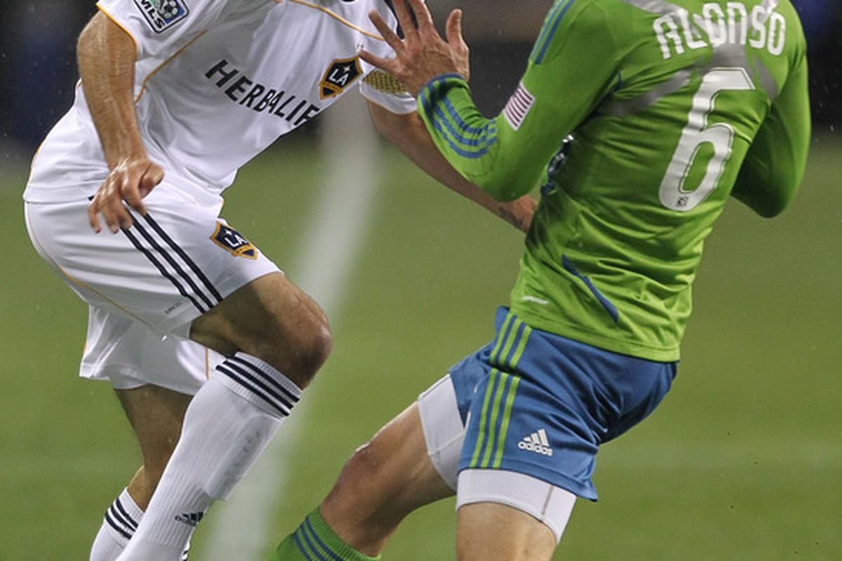 SEATTLE - MARCH 15:  Landon Donovan #10 of the Los Angeles Galaxy battles Osvaldo Alonso #6 of the Seattle Sounders FC at Qwest Field on March 15, 2011 in Seattle, Washington. (Photo by Otto Greule Jr/Getty Images)