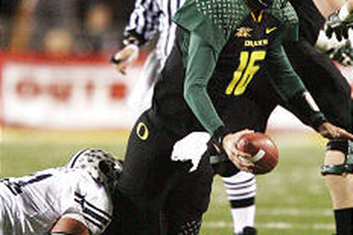 Brigham Young University's Russell Tialavea sacks Oregon QB Brady Leaf during the Las Vegas Bowl.