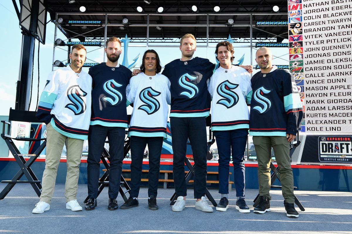 The Seattle Kracken draft picks (L-R) Jordan Eberle, Chris Driedger, Chris Tanev, Jamie Oleksiak, Haydn Fleury and Mark Giordano following the 2021 NHL Expansion Draft at Gas Works Park on July 21, 2021 in Seattle, Washington. The Seattle Kraken is the National Hockey League's newest franchise and will begin play in October 2021.