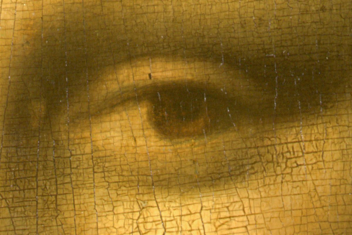 """A detail of the left eye of Leonardo da Vinci's 16th century masterpiece the """"Mona Lisa."""" New reports indicate that coronavirus can linger in someone's eye longer than their mouth, throat or nose."""