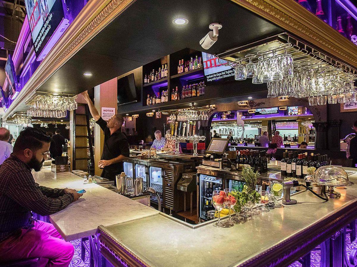 Neon lit bar inside Bombay Darbar