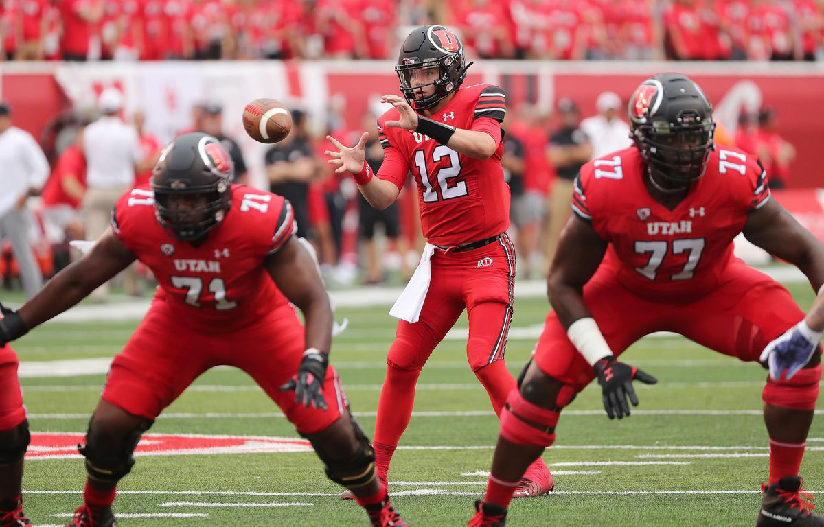 Utah Utes quarterback Charlie Brewer (12) takes a snap during the season opener at Rice-Eccles Stadium in Salt Lake City on Thursday, Sept. 2, 2021. Weber lead 7-3 at the lightning strike delay.