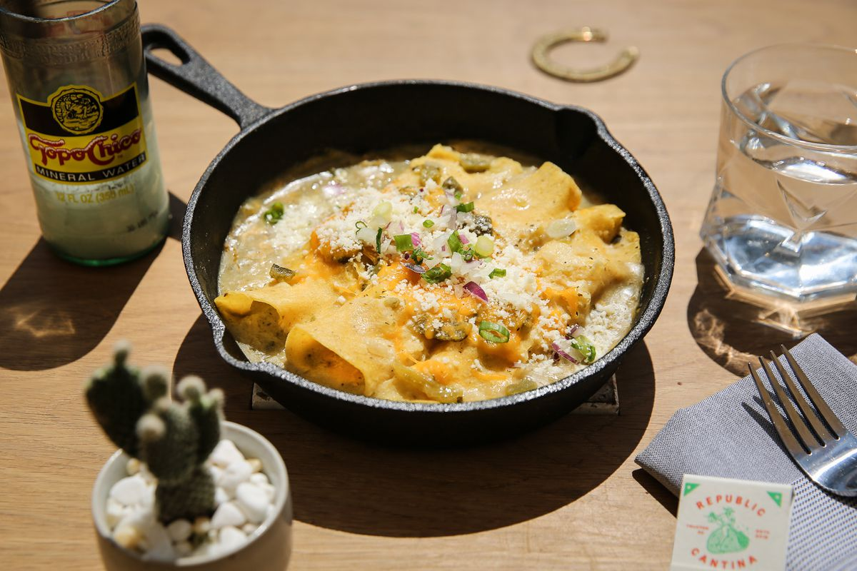 A skillet of poblano chile chicken enchiladas from Republic Cantina.
