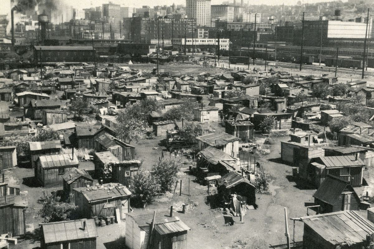 The American Depression 1930s: Thousands of jobless lived in shanty towns nicknamed 'Hoovervilles', earning a few cents a day sorting bottles and cans. This 'Hooverville' was located near the waterfront in Seattle.