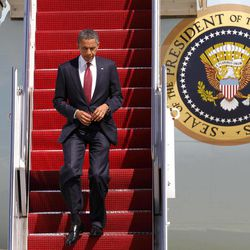 President Barack Obama exits Air Force One upon his return from Fort Stewart, Ga., Friday, April 27, 2012, at Andrews Air Force Base, Md.