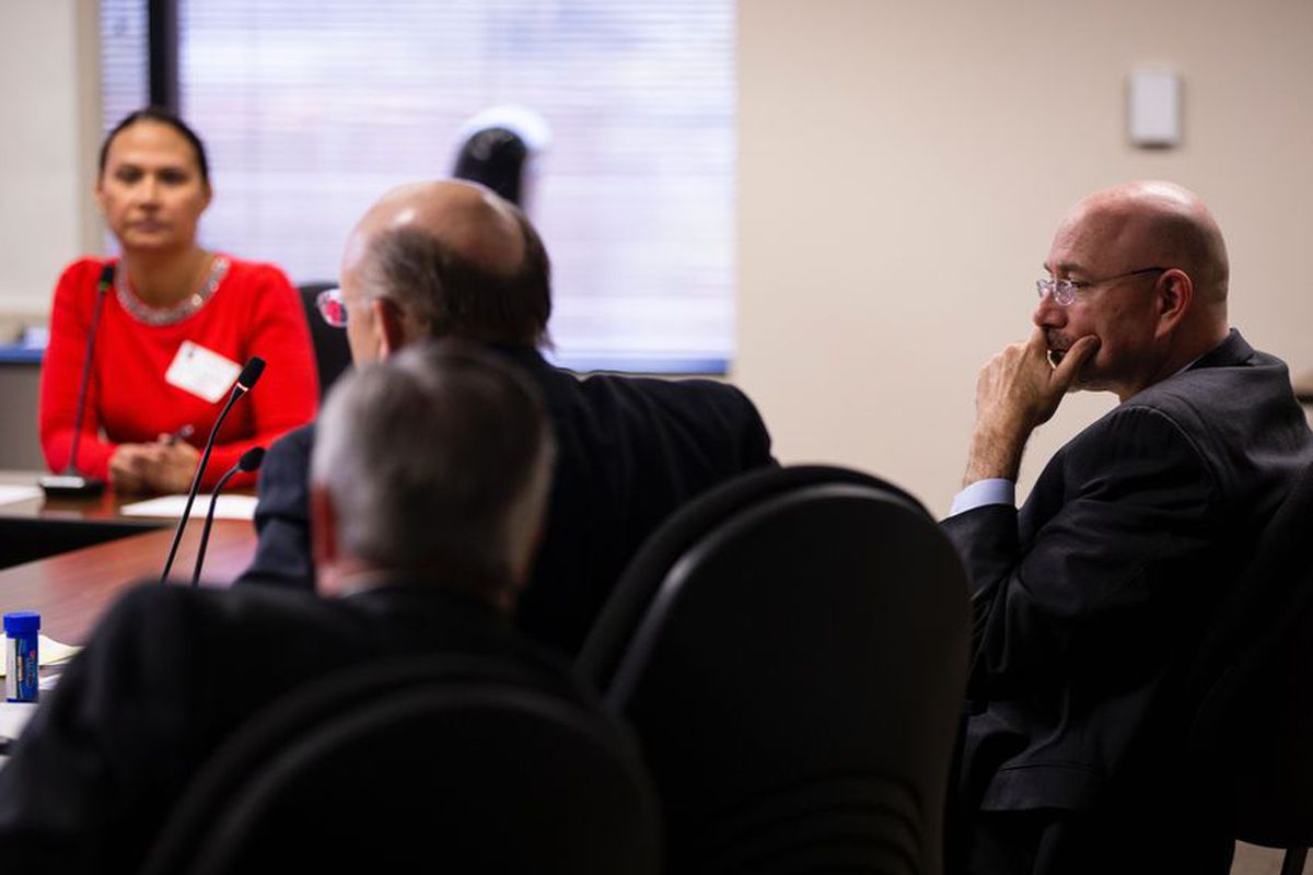 Mike Feinberg, right, sits with his lawyers, Christopher L. Tritico, left, and Ron S. Rainey while a former KIPP employee testifies during a hearing on Feb. 12, 2020. Feinberg, a co-founder of KIPP, was dismissed in 2018 after a sexual misconduct investigation. Eddie Gaspar/The Texas Tribune