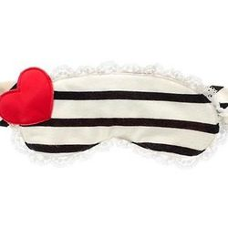 """Bella stripe eye mask, $24 at <a href=""""http://www.juicycouture.com/Bella-Stripe-Eye-Mask/605579749277.html""""target=""""_blank"""">Juicy Couture</a>"""