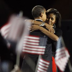 President-elect Barack Obama and his wife Michelle embrace after he delivered his victory speech in Grant Park. | AP photo