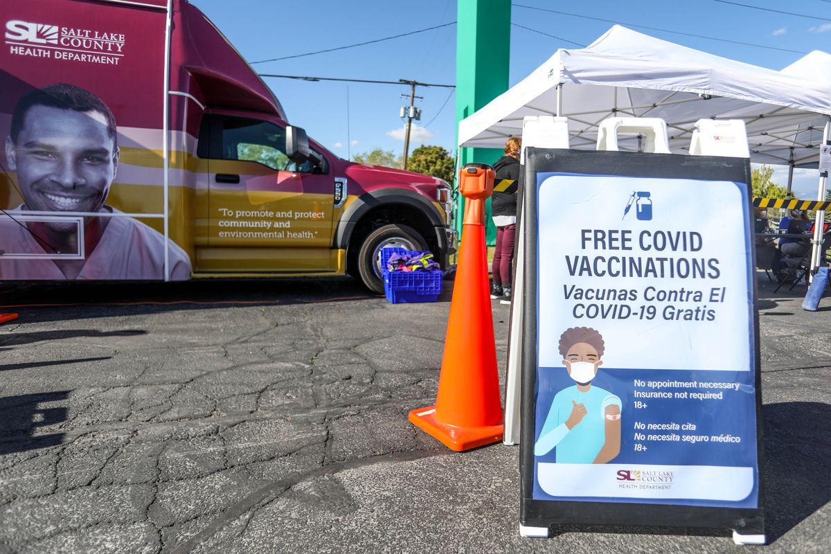 Utahns walk up to get a COVID-19 vaccinate at a pop-up vaccination event at Reams in Magna, Utah.