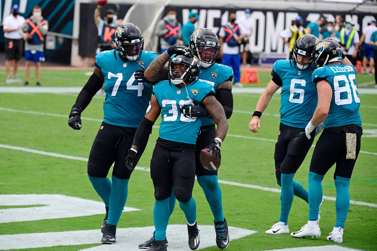 James Robinson #30 of the Jacksonville Jaguars celebrates with teammates after rushing for a touchdown during the first half against the Houston Texans at TIAA Bank Field on November 08, 2020 in Jacksonville, Florida.