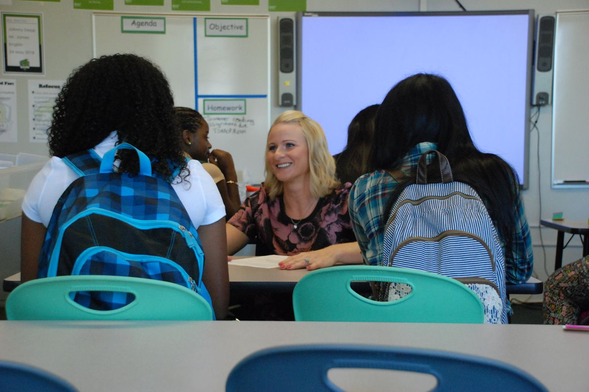 A teacher at DSST Cole High in Denver greets her students on the first day of class in 2014.
