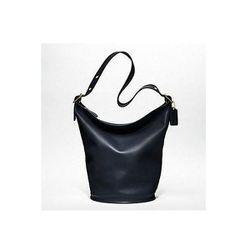 "Classic Leather Duffle in Navy, $398 at <a href=""http://www.coach.com/online/handbags/-handbags_feature_coachorig-us-us-5000000000000052055-en?t1Id=62&t2Id=5000000000000052055&tier=2&LOC=LN#98251"">Coach</a>"
