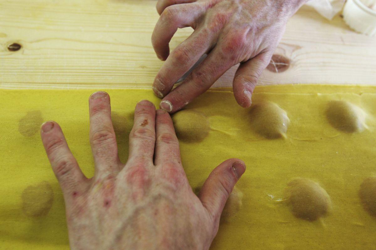A chef makes red turnip ravioli