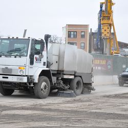 Street sweeping truck on Waveland being kept busy by the dirt being left behind by trucks exiting the work site