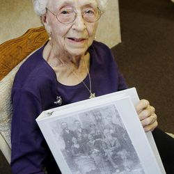 In this March 30, 2012, photo, Verla Morris, who will turn 100 later this year, poses for a photo with some of her family census data from the 19th and 20th centuries at her local residential senior center in Chandler, Ariz. When the 1940 census records are released Monday, April 2, Morris will see her own name and details about her life in the records being released after 72 years of confidentiality expires, allowing her to find out more about her family tree.