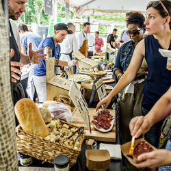 Chefs make food for the masses at the tasting tents in Piedmont Park during the Atlanta Food & Wine Festival on Sunday.