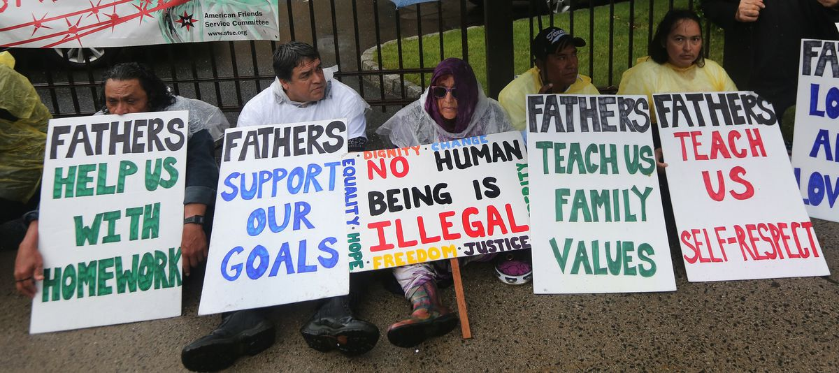 Protesters with father signs