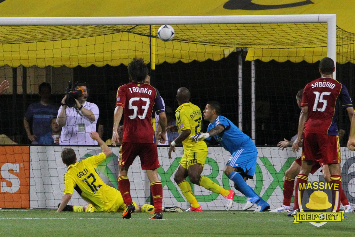 Gaven poaches a shot against RSL's Nick Rimando to put the Crew up 2-0. (Fahmi/MassiveReport.com)