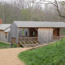 The rebuilt sawmill is in Historic Kirtland Village, with the ashery to the left.