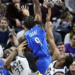 Utah Jazz center Ekpe Udoh (33) fouls Oklahoma City Thunder forward Jerami Grant during NBA basketball in Salt Lake City on Saturday, Dec. 23, 2017. At right is Utah Jazz guard Alec Burks.
