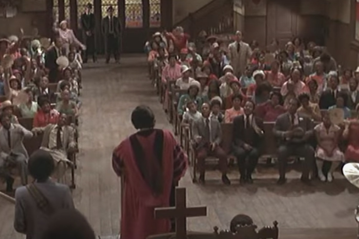 """Reverend Cleophus James (James Brown) leads the congregation in """"The Old Landmark"""" during Sunday services at Triple Rock Church (Pilgrim Baptist Church in Chicago) in a scene from """"The Blues Brothers."""""""