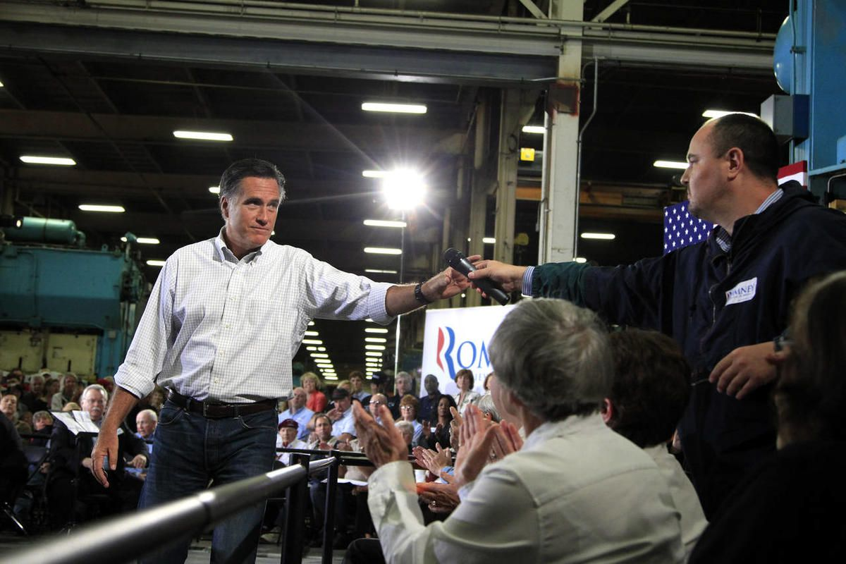 Republican presidential candidate, former Massachusetts Gov. Mitt Romney takes the microphone after listening to a question from a supporter at a town hall-style meeting in Euclid, Ohio, Monday, May 7, 2012.