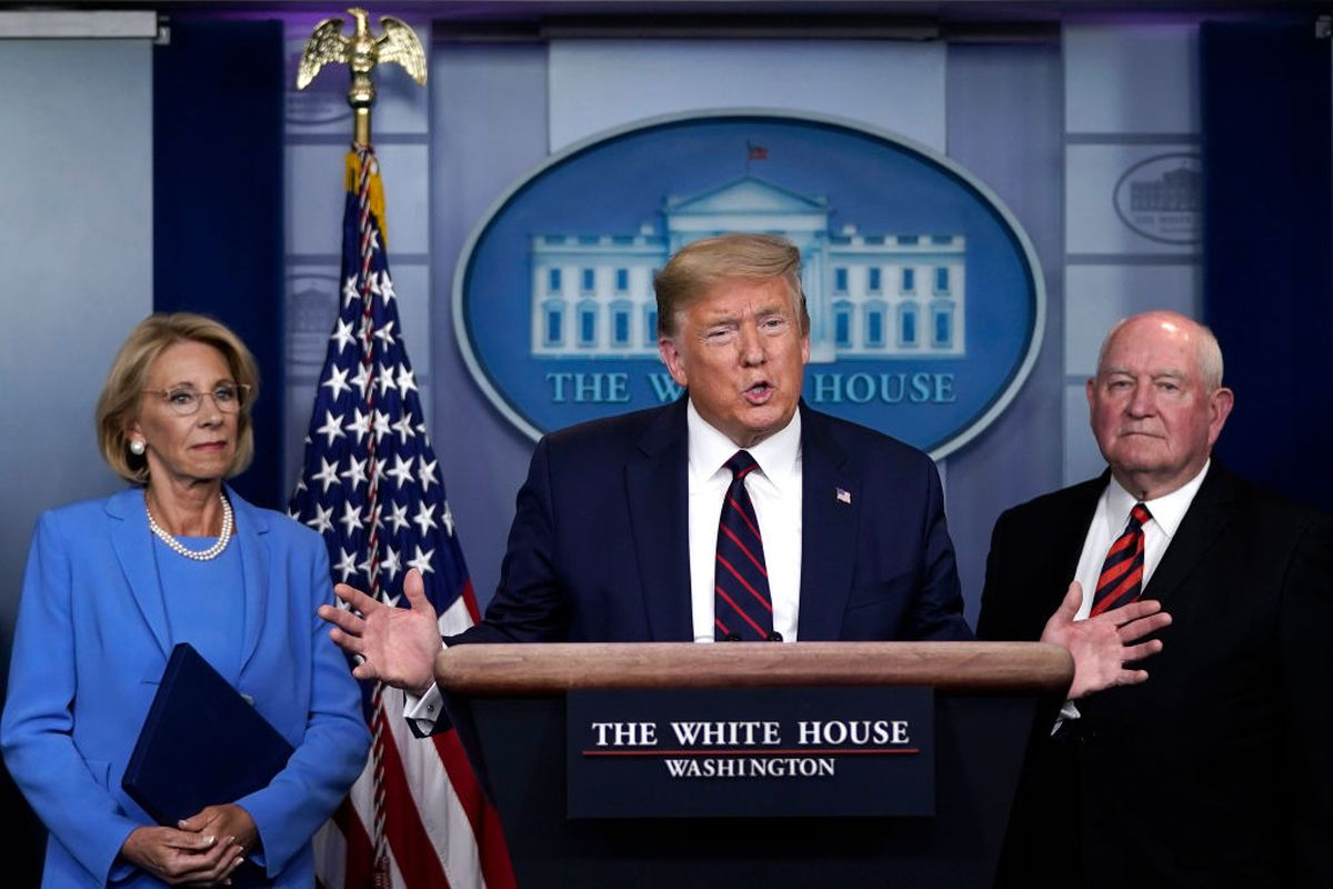 U.S. President Donald Trump has Secretary of Education Betsy DeVos and Secretary of Agriculture Sonny Perdue look on during a briefing on the coronavirus pandemic in the press briefing room of the White House on March 27, 2020 in Washington, DC. (Photo by Drew Angerer/Getty Images)