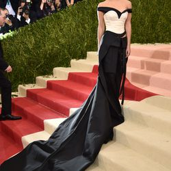 Emma Watson wears a Calvin Klein dress-slash-pants made out of recycled plastic bottles.