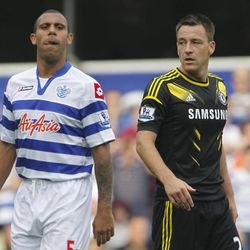 Queens Park Rangers' Anton Ferdinand, left, is marked by Chelsea's John Terry as Chelsea defend a corner during their English Premier League soccer match at Loftus Road stadium, London, Saturday, Sept. 15, 2012.