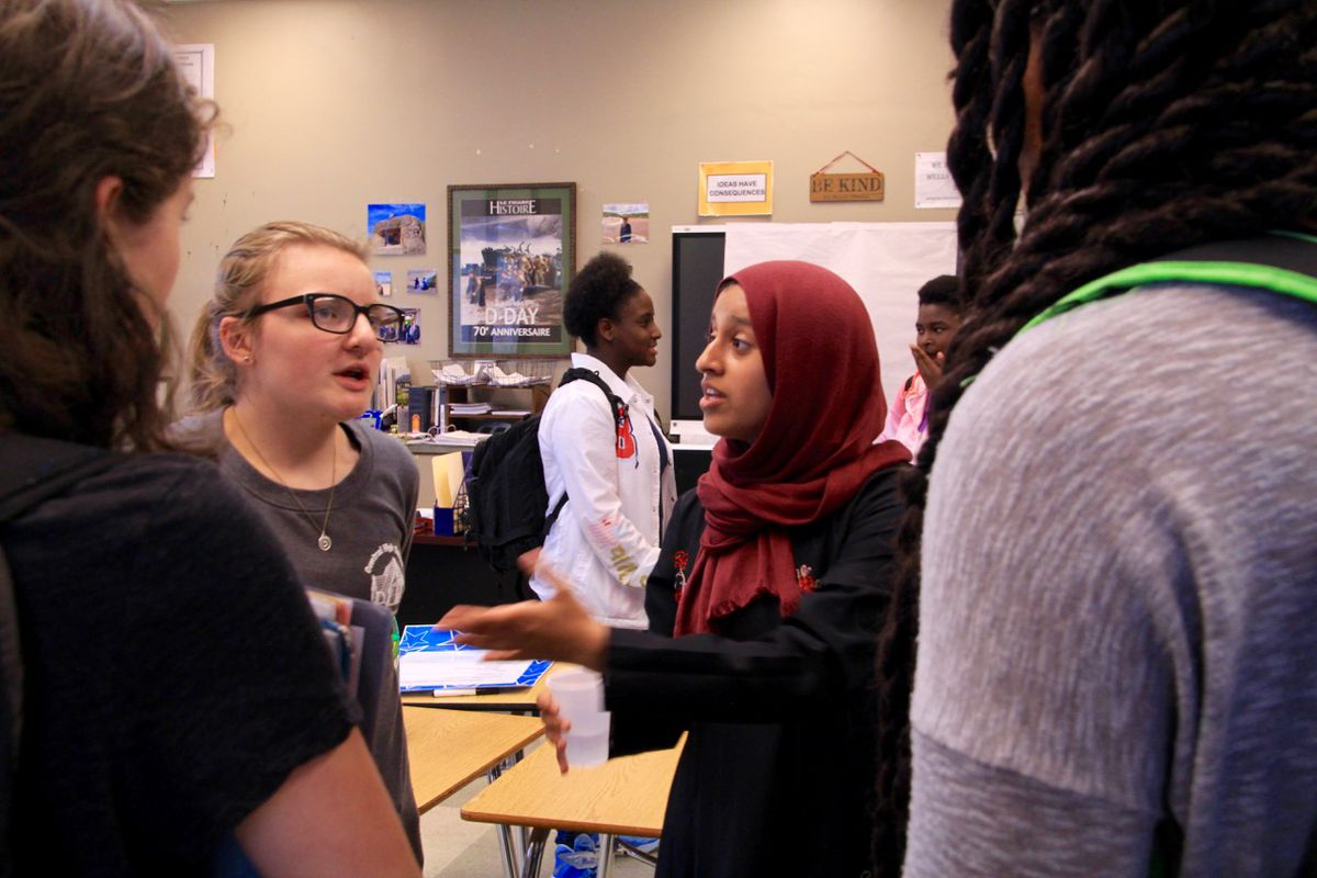 From left: Audrey Firrone and Amal Altareb talk with their peers during an after-school club meeting at Central High School. The two Memphis students helped to found Courageous Conversations.