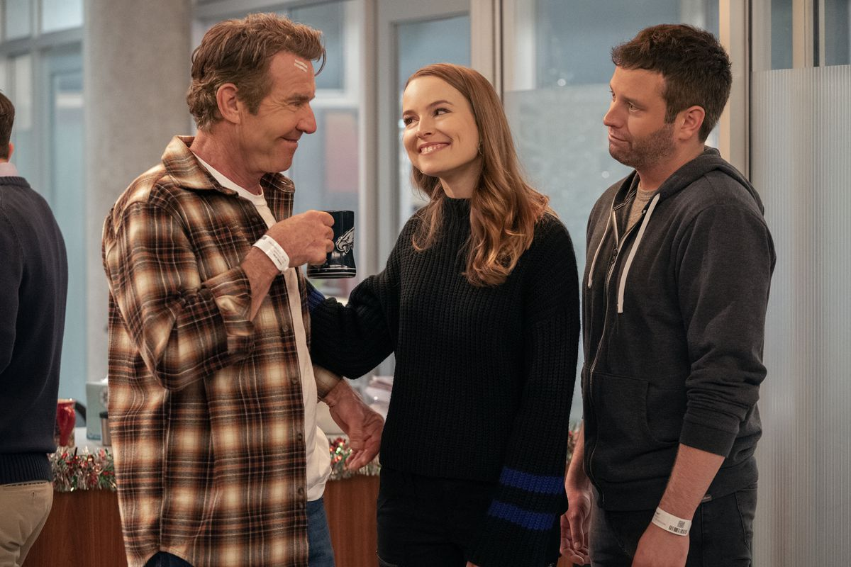 bridgit mendler smiles at her father, dennis quaid, patting him on the back, while her boyfriend played by Brent Morin stands behind her