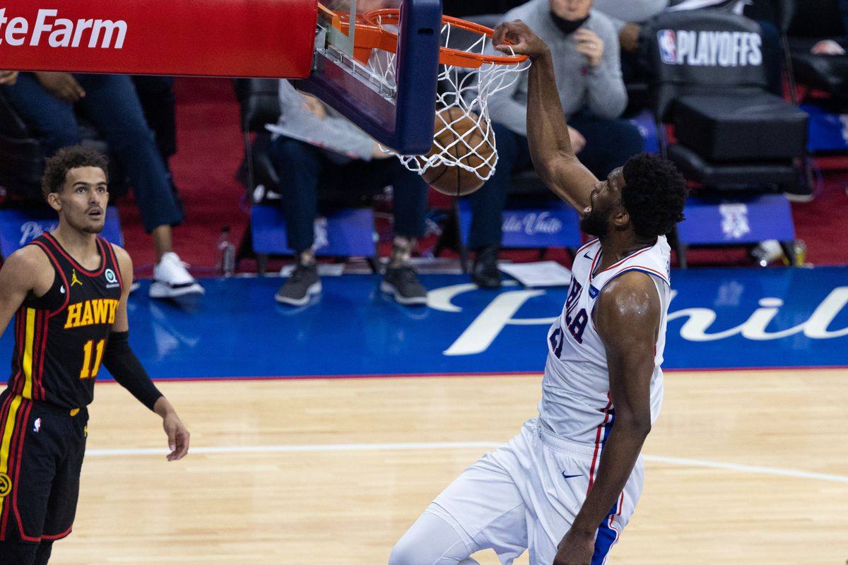 Philadelphia 76ers center Joel Embiid (21) dunks the ball against Atlanta Hawks guard Trae Young (11) during the second quarter of game seven of the second round of the 2021 NBA Playoffs at Wells Fargo Center.