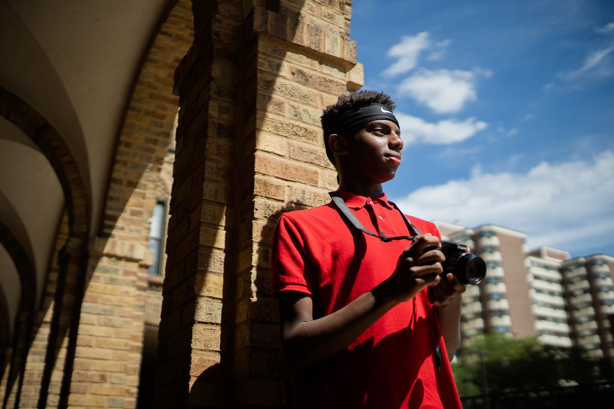 """Zachary Slaughter, 14, of Flossmoor, a budding photographer, co-published the book, """"Boarded up Chicago: Storefront Images Days After the George Floyd Riots,"""" with his father, Christopher Slaughter. The two drove the city after the destruction and looting that followed peaceful protests in the wake of the George Floyd police killing, taking photos of the history soon to disappear in the prolific art on plywood. In South Shore on Aug. 29."""
