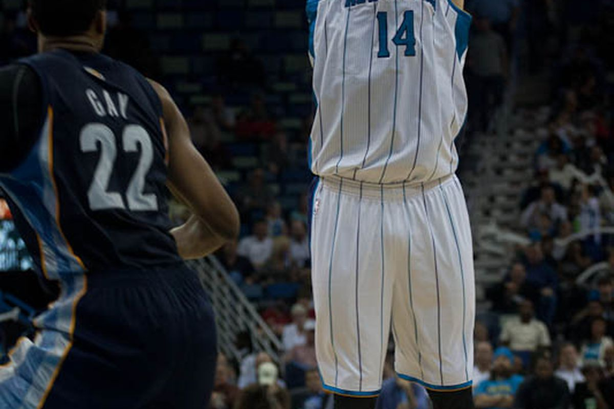 New Orleans Hornets' forward/center Jason Smith as he takes a jumpshot over Memphis Grizzlies' forward Rudy Gay in a preseason game on December 21st, 2011 in the New Orleans Arena. Photo courtesy of Storm Surge Photo's Matthew McIntosh.