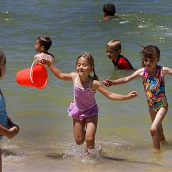 Oquirrh Lake in the center of Daybreak is a hot spot for families to bring children to play.