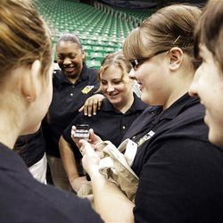 The Kearns High School Madrigals listen to instructions from their choir director via cell phone as they wait to audition for a chance to sing the national anthem during Utah Jazz games this season.