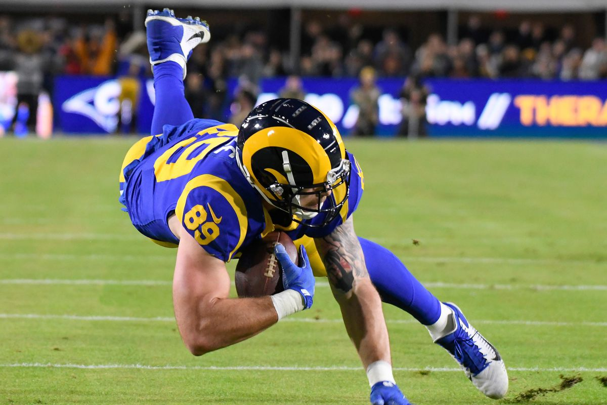 Los Angeles Rams tight end Tyler Higbee dives after making a catch in the second quarter against the Seattle Seahawks at Los Angeles Memorial Coliseum.
