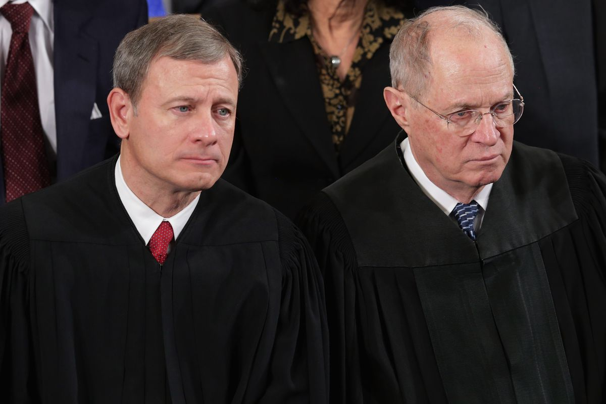 Chief Justice John Roberts with Associate Justice Anthony Kennedy in 2014.