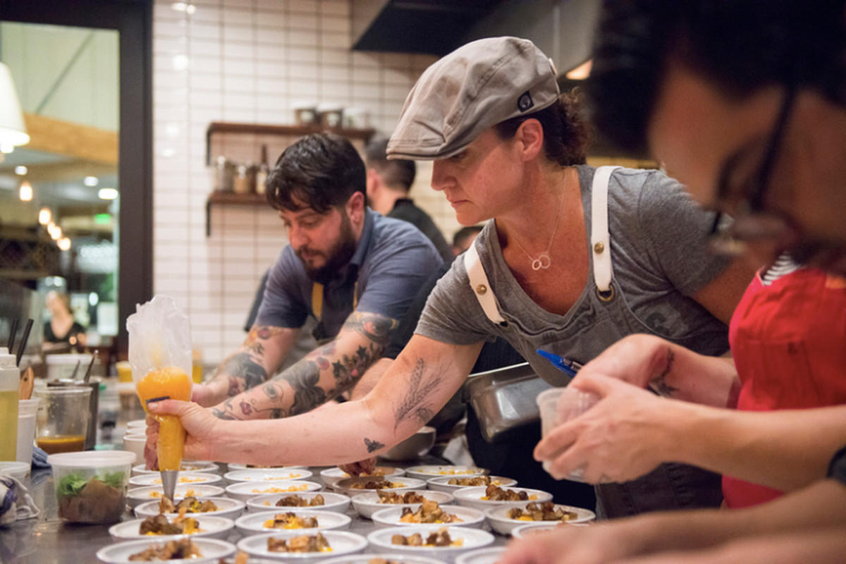 Chefs Brett Cooper and Brooke Mosley plating during Indie Chefs Week in 2014