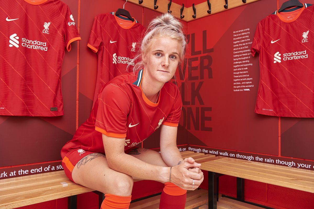 jasmine Matthews poses for photos as she signs to re-join Liverpool FC Women at Solar Campus on June 18, 2021 in Wallasey, England.