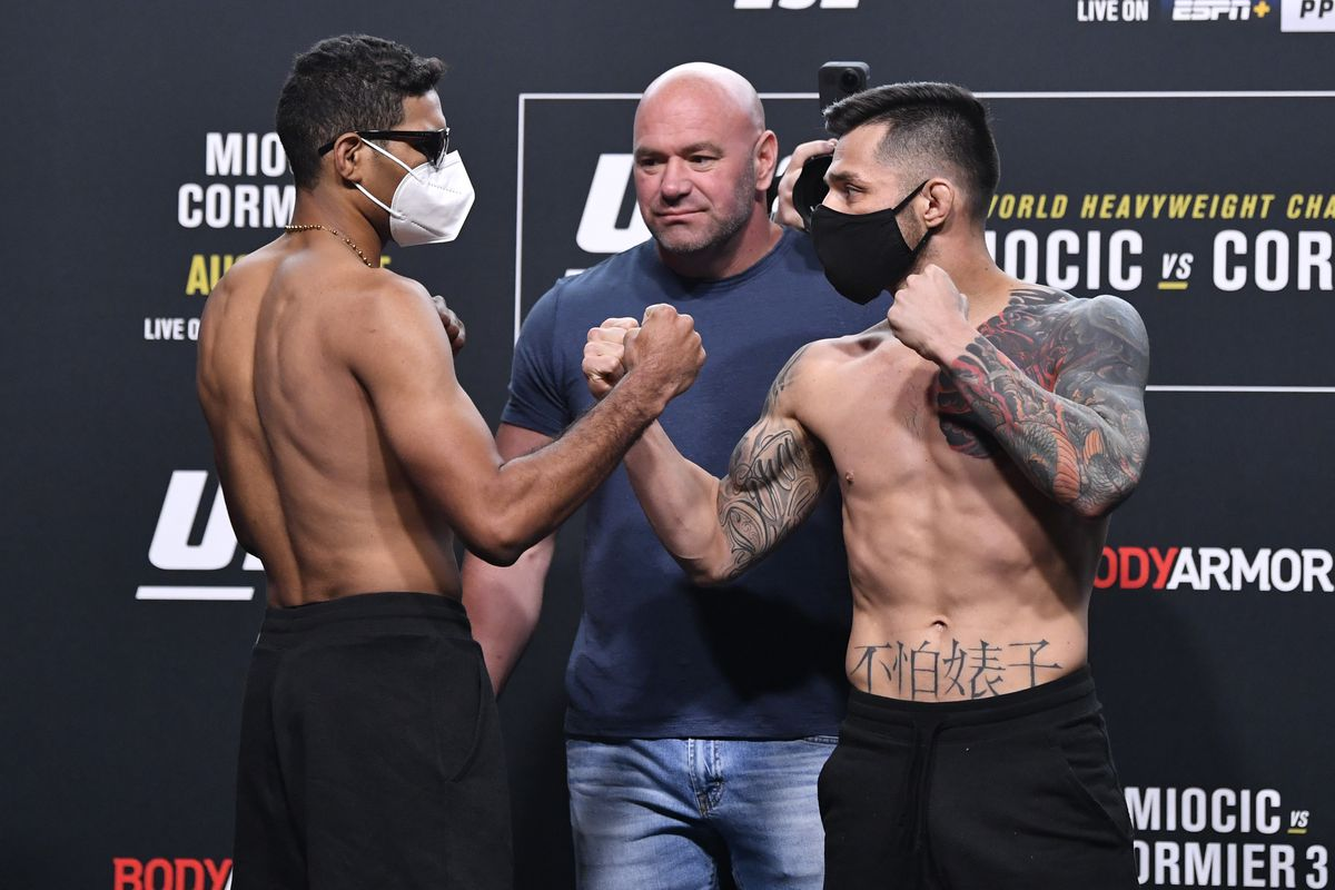 Opponents Herbert Burns of Brazil and Daniel Pineda face off during the UFC 252 weigh-in at UFC APEX on August 14, 2020 in Las Vegas, Nevada.