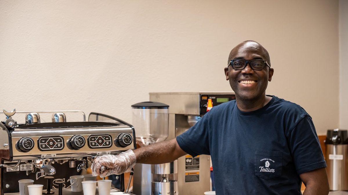 A man at an espresso machine