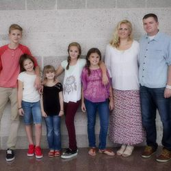 Evie Clair is photographed with her family.