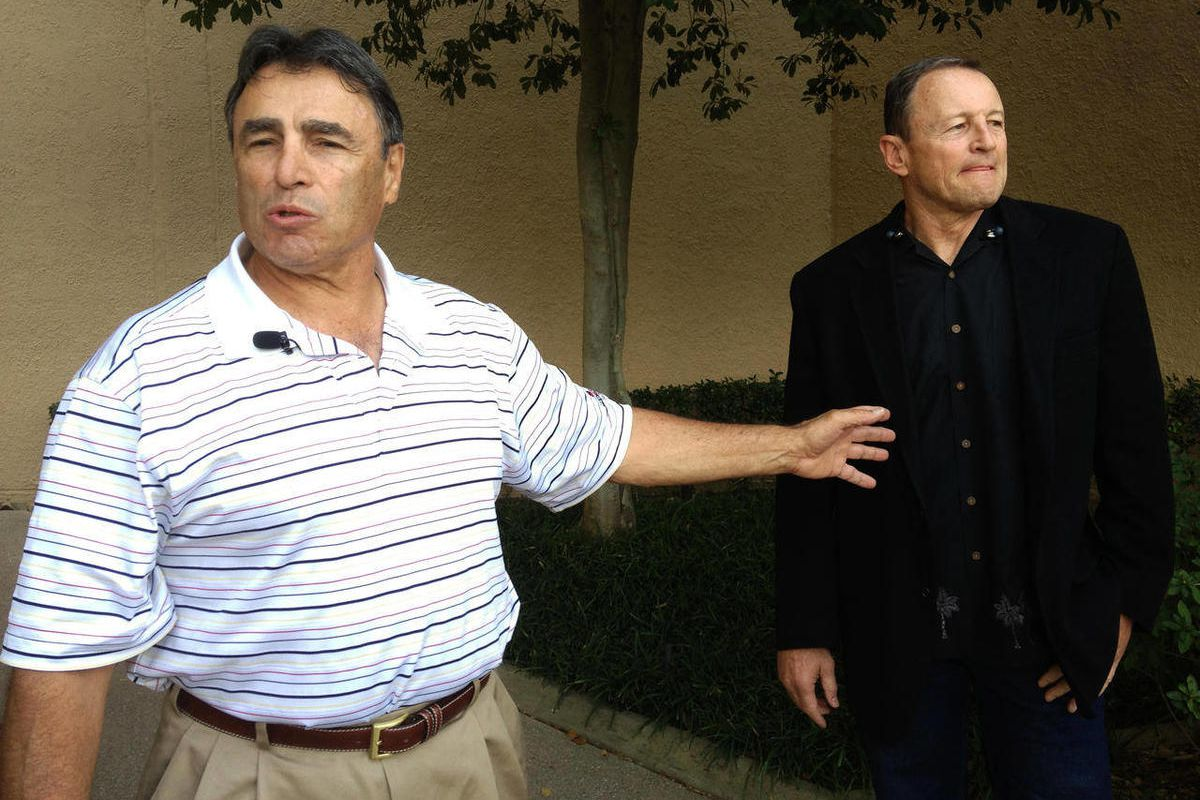 NFL head linesman Tom Stabile, left, and referee Ed Hochuli arrive at an Irving, Texas hotel Friday, Sept. 28, 2012. Officials started arriving Friday to discuss and vote on an agreement reached with the league late Wednesday. Some planned to fly directly